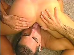 Two attractive guys enjoy duo blowjob on the floor