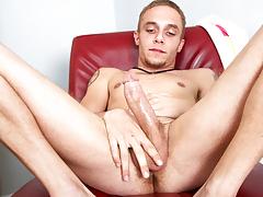 lean tattooed stud jerks off his big knob for the camera