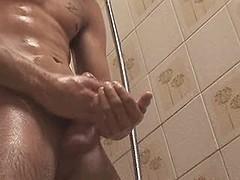 Pretty dude jerks off his stiff cock in the shower