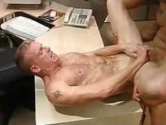 Hairy stud gets deep anal penetration on table