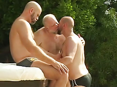 Three bear mature gays kiss by pool