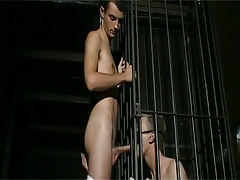 Bad twink in cage sucks hard cock