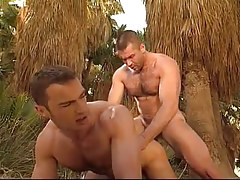 Hairy gay man fucks dude in doggy style in jungle