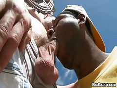 Black thug throats cock outdoor