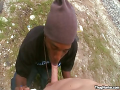 Young black gay sucks white cock outdoor