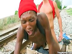 Ebony gay boy gets anal fuck behind on railyard